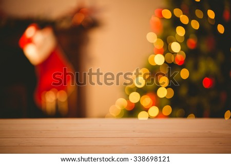 Desk with christmas tree in background - stock photo