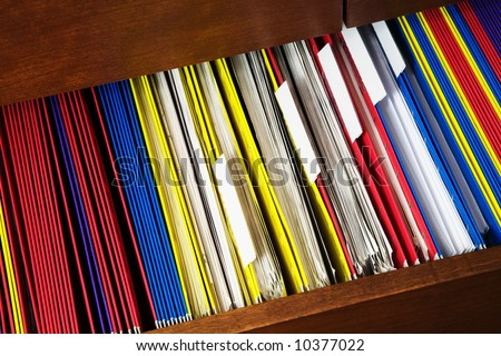 Desk with opened file drawer - stock photo