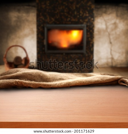desk with sack with fireplace and wall