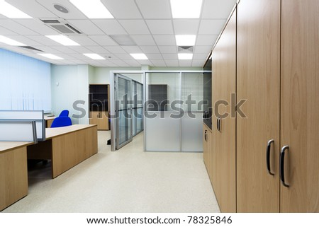 desks and cabinets in a modern office - stock photo