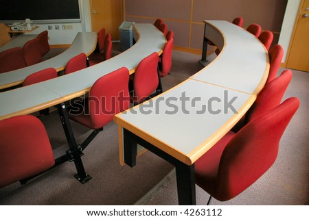 Desks and chairs in lecture room