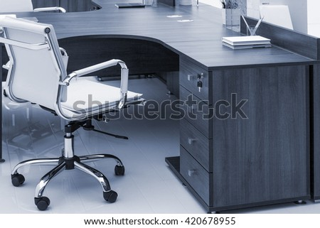 desks and white leather armchairs in the office - stock photo