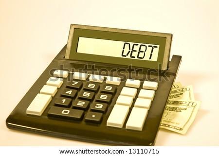 """Desktop calculator displays the word """"debt"""". - stock photo"""