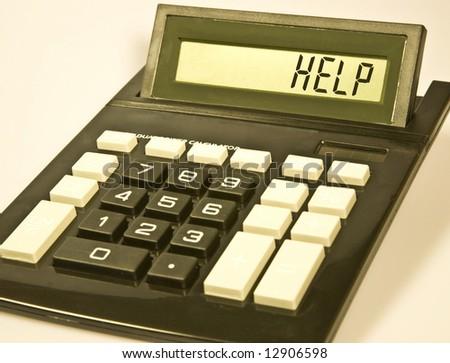 """Desktop calculator displays the word """"help"""". - stock photo"""