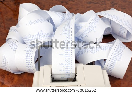 desktop calculator with calculating strip. symbol for costs, - stock photo