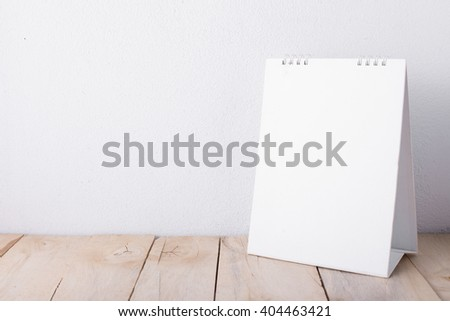 desktop calendars with wooden floor on white background
