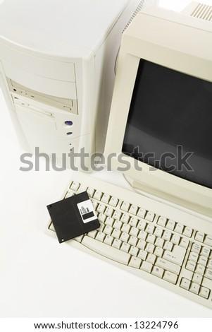 Desktop Computer and floppy Disk close up shot - stock photo