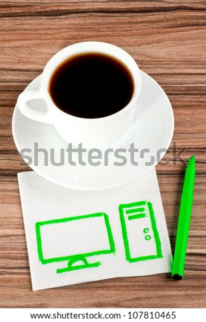 Desktop computer on a napkin and cup of coffee - stock photo