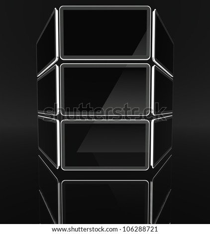 Desktop computer screens on black background with text space - stock photo