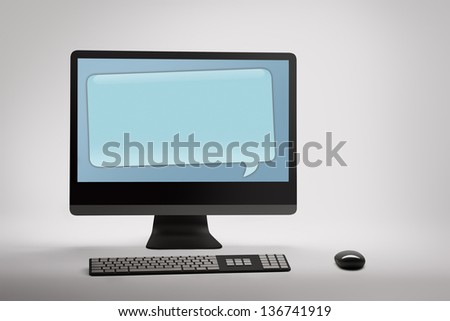 Desktop computer with blank speech bubble on white background - stock photo