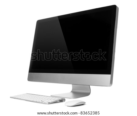 Desktop computer with wireless keyboard and mouse - stock photo