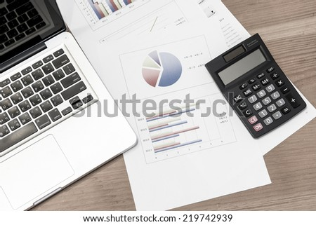 Desktop in stock exchange office with a tablet pc showing stock market chart. - stock photo