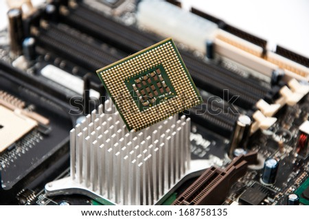Desktop motherboard with CPU on a white background - stock photo