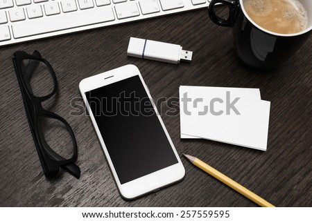 Desktop smartphone and business card mockup - stock photo