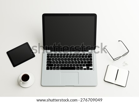 desktop with laptop, tablet, book and coffee cup - stock photo