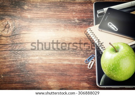 Desktop with tablet pc, smartphone and green apple. Copy space  - stock photo