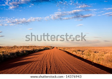 desolate road to horizon with deep blue sky