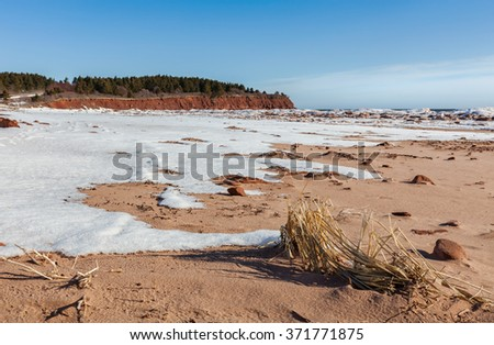 Desolate sand beaches in winter in Prince Edward Island National Park. - stock photo