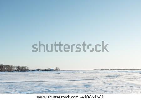 desolate winter landscape near the village - stock photo