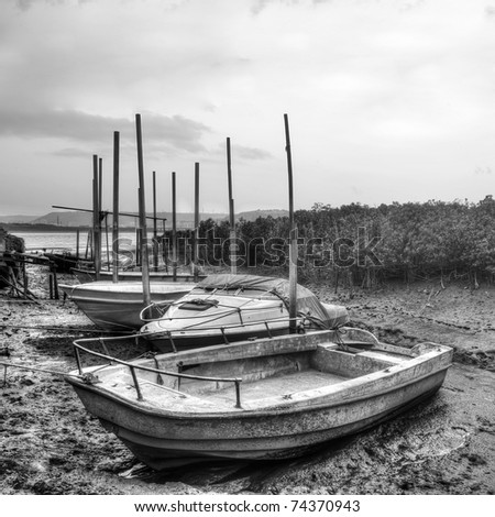 Desolated boats in pier in black and white. - stock photo