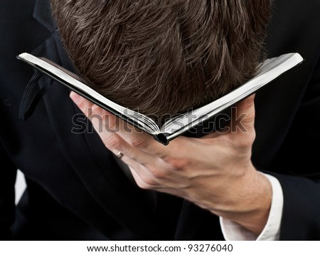 Despair. Businessman head omitted on notebook