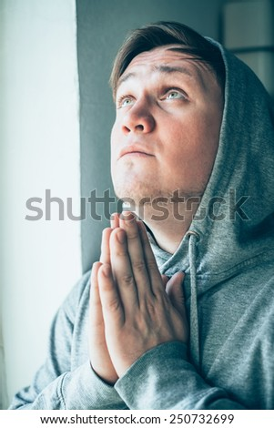 Despair man praying God - stock photo