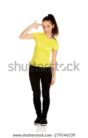 Despair teenager woman showing suicide sign. - stock photo