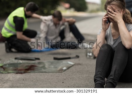 Despair young female driver after traffic accident - stock photo