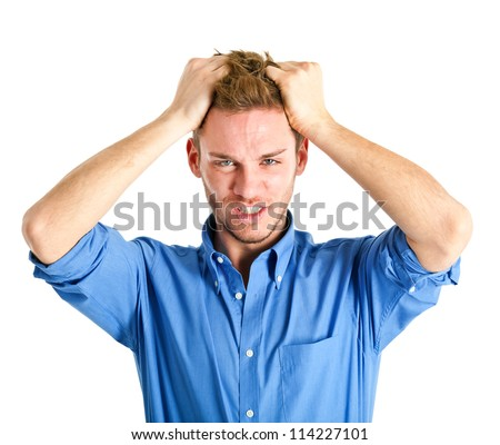 Despaired businessman pulling his hair - stock photo