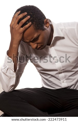 desperate african businessman on white background - stock photo