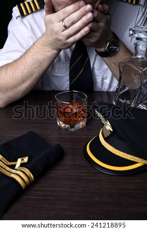 Desperate and plunged pilot drink alcohol - stock photo
