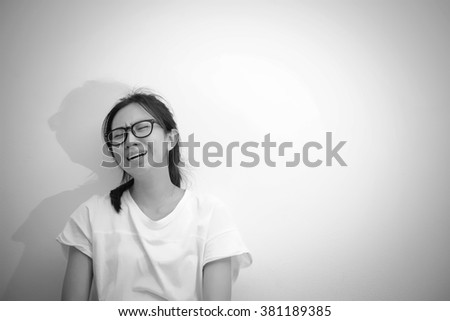 Desperate asian woman crying in monochrome