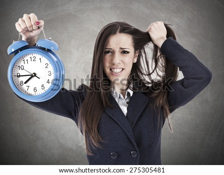 desperate business woman with clock - stock photo