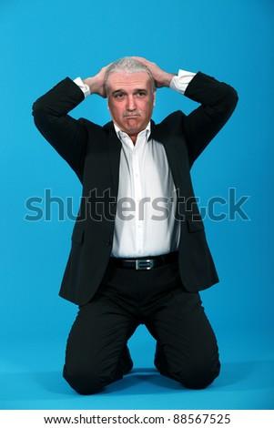 Desperate businessman - stock photo