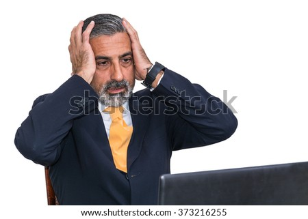 Desperate businessman. Alone in his office, in front of the desk with the computer, it panic, depression. - stock photo
