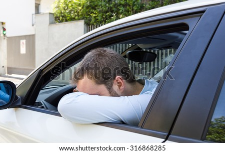 Desperate businessman driving his car