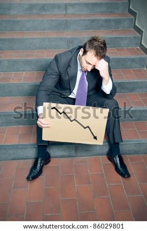 Desperate businessman showing negative graph - stock photo