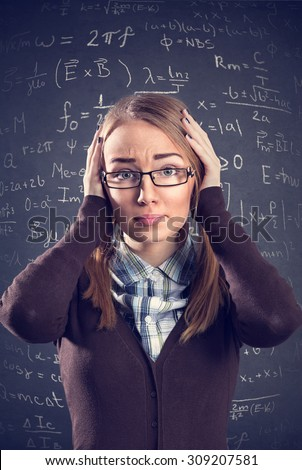 Desperate female student confused with math formulas - stock photo