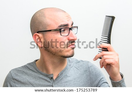 Desperate man for his baldness - stock photo