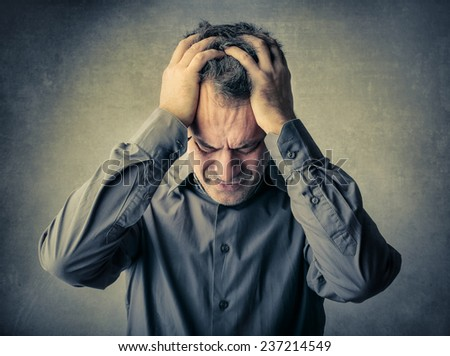 Desperate man regretting something  - stock photo