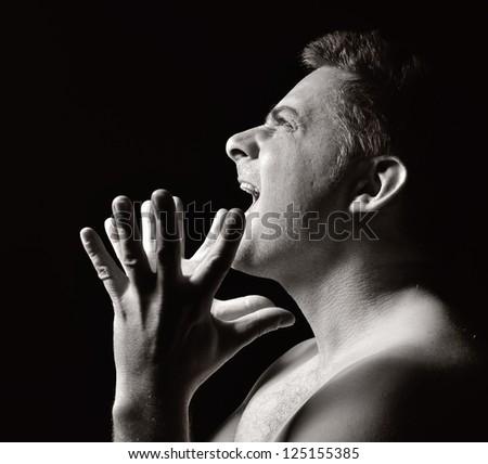 Desperate man, shouting and raging. - stock photo