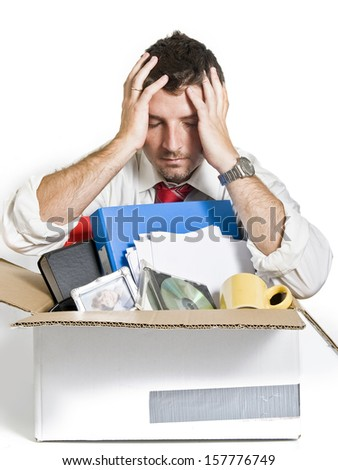 Desperate Man with Cardboard Box fired from Job - stock photo