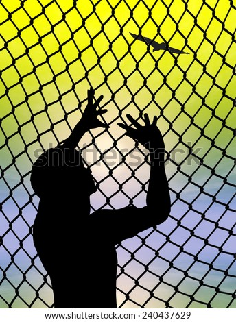 Desperate prisoner or refugee behind a fence longing for to live a free life - stock photo
