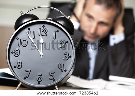 Desperate senior businessman being close to ruin - clock showing five minutes to twelve. - stock photo
