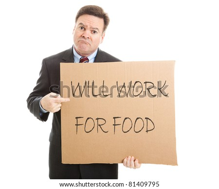 """Desperate, unemployed businessman holding up a message on a cardboard box that says """"Will Work For Food"""". - stock photo"""