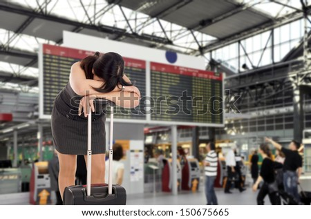 desperate woman at the airport / airport - stock photo