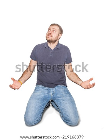 desperate young man on his knees - stock photo