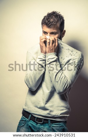 Desperate young man with hand on face