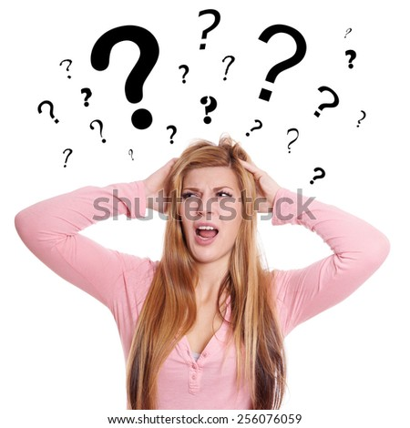desperate young woman is looking utterly confused with question marks above her head - stock photo