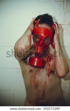 desperation naked man with red gas mask, blood, despair and suicide - stock photo